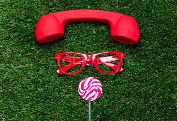 Czerwony okulary lizak zielona trawa powrót Zdjęcia stock © Massonforstock