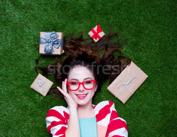Portrait of a young redhead woman with present gifts Stock photo © Massonforstock