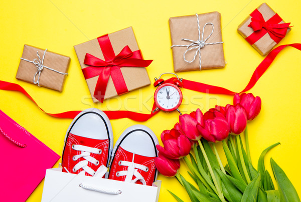bunch of red tulips, red gumshoes, cool shopping bags, ribbon, a Stock photo © Massonforstock