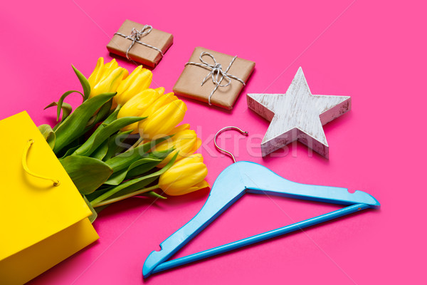 bunch of beautiful yellow tulips in cool yellow shopping bag, ha Stock photo © Massonforstock