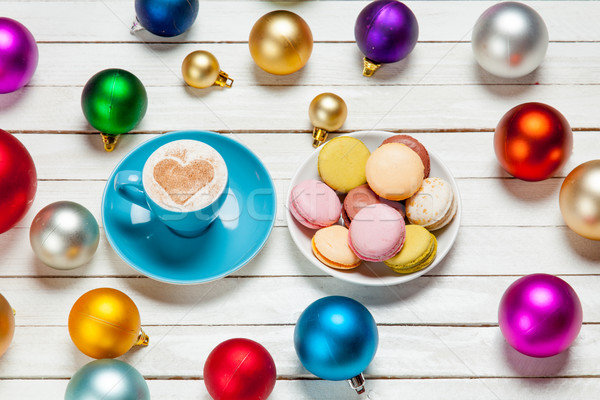 photo of blue cup of coffee and plate full of macaroons near col Stock photo © Massonforstock