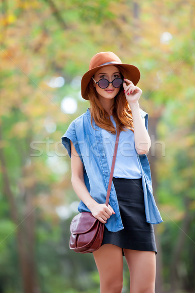 photo of beautiful young woman standing on the wonderful autumn  Stock photo © Massonforstock