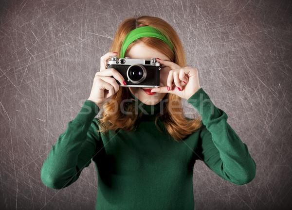 American redhead girl with camera.  Stock photo © Massonforstock
