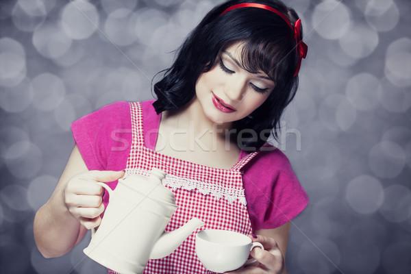 Morena mulheres bule copo menina cara Foto stock © Massonforstock
