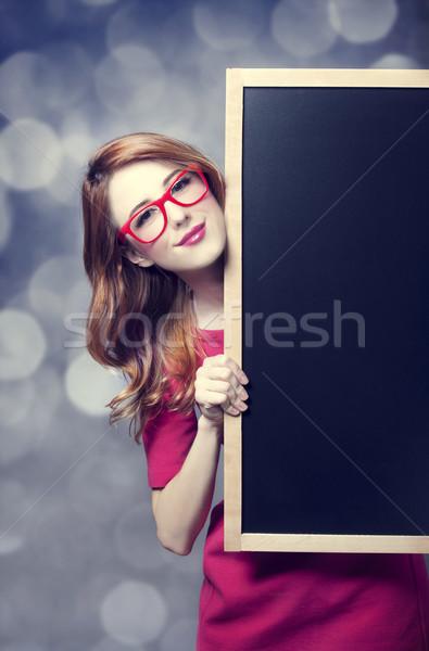 Vörös hajú nő diák iskolatábla nő szemüveg tanulás Stock fotó © Massonforstock