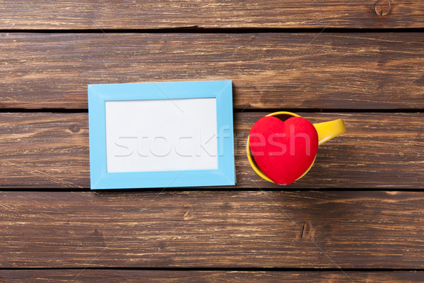 Photo frame and heart shape toy Stock photo © Massonforstock