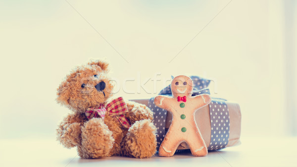 cute teddy bear, gingerbread man and beautiful gift on the wonde Stock photo © Massonforstock