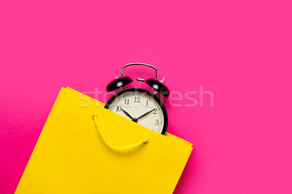 cool black alarm clock in beautiful yellow shopping bag on the w Stock photo © Massonforstock