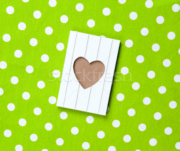 photo of cool postcard on the wonderful green dotted background  Stock photo © Massonforstock