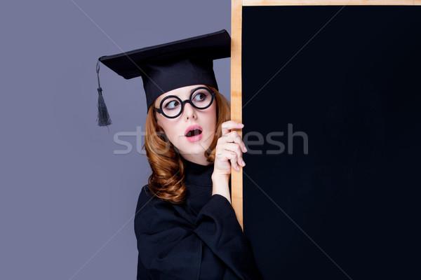 Stock photo: photo of beautiful young alumnus with blackboard on the wonderfu