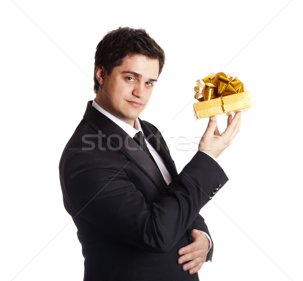 A man holding present box in formal black tux Stock photo © Massonforstock