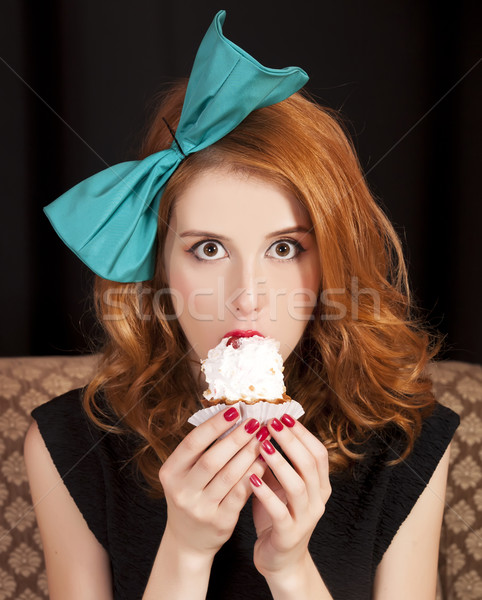 Redhead girl secretly eating cake. Stock photo © Massonforstock