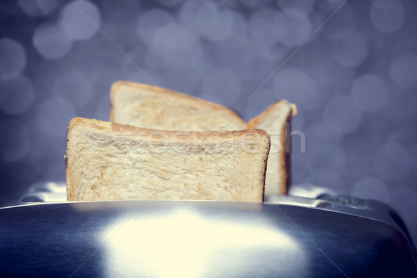 Close-up shot of a bread toast in a toaster Stock photo © Massonforstock
