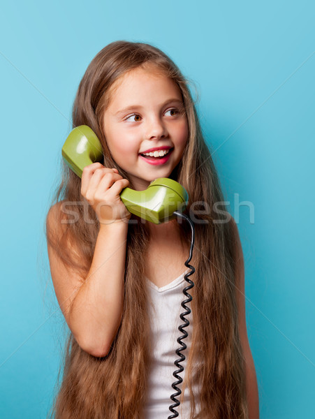 Young smiling girl with green handset  Stock photo © Massonforstock