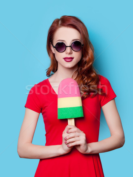 girl in red dress with toy ice-cream Stock photo © Massonforstock