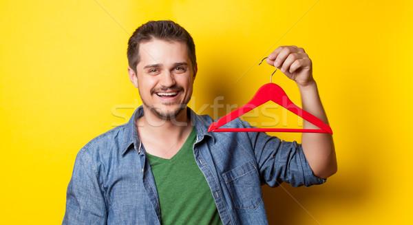 男 ハンガー 黄色 小さな 笑みを浮かべて 手 ストックフォト © Massonforstock
