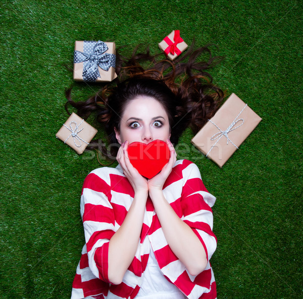 Portrait of a young styled redhead woman with heart shape gift a Stock photo © Massonforstock