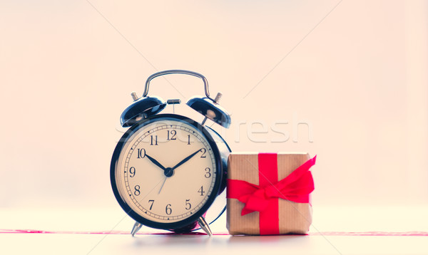 big red alarm clock. dotted ribbon and beautiful gift on the won Stock photo © Massonforstock