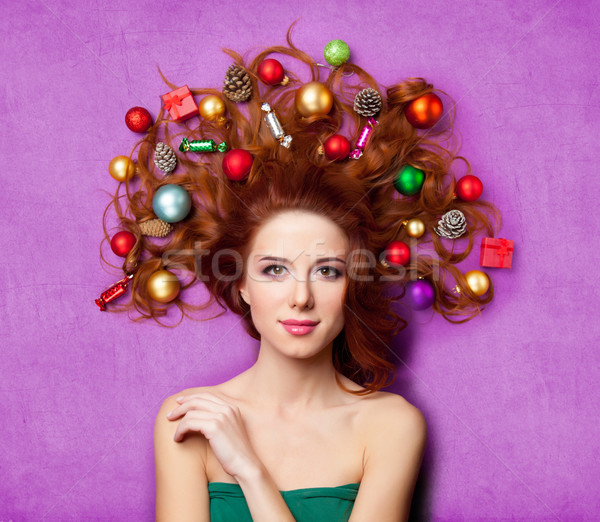beautiful young woman with gifts, candies, baubles and cones in  Stock photo © Massonforstock