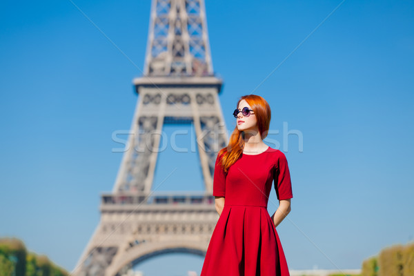 beautiful young woman on the Eiffel Tower background Stock photo © Massonforstock