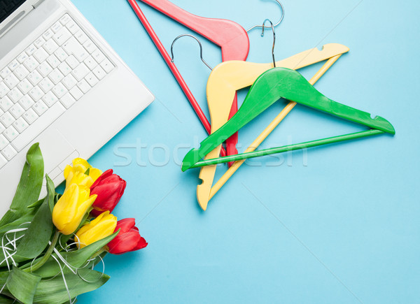photo of bunch of tulips, colorful hangers and laptop on the won Stock photo © Massonforstock
