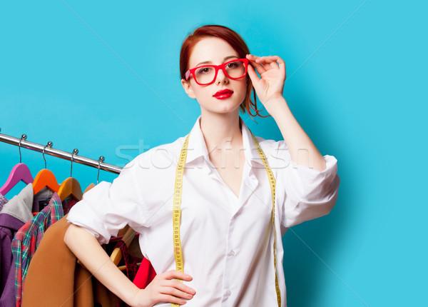 Photo belle jeune femme centimètre vêtements merveilleux Photo stock © Massonforstock