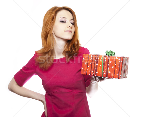 Girl in red with present box. Stock photo © Massonforstock