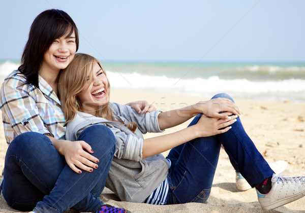 Two girls at outdoor near sea Stock photo © Massonforstock