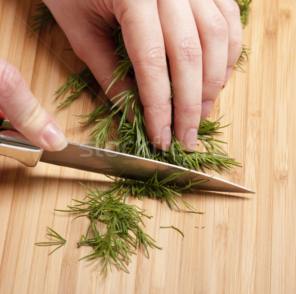 Female cutting dill Stock photo © Massonforstock