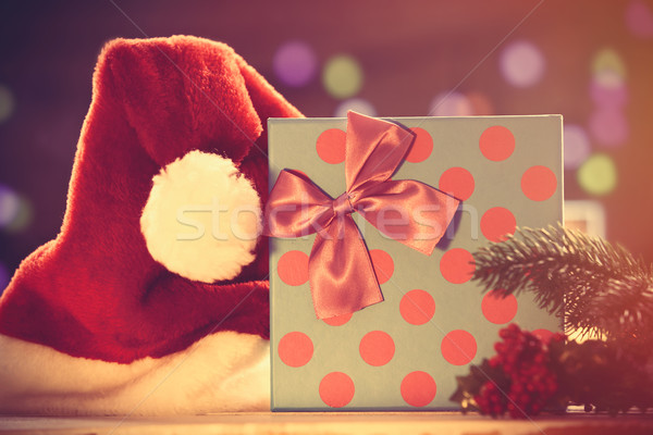 Santas hat and gift box with Cristmas lights  Stock photo © Massonforstock
