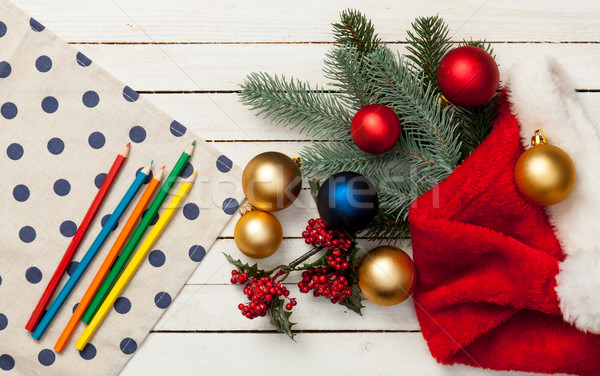 Napkin and pencils with baubles Stock photo © Massonforstock