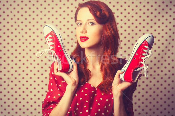 Portrait of redhead girl with gumshoes  Stock photo © Massonforstock