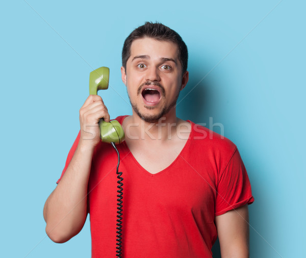 guy in t-shirt with green retro dial phone  Stock photo © Massonforstock