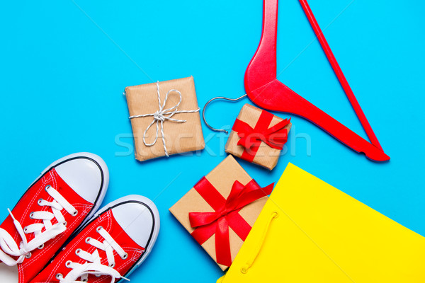 big red gumshoes, cool shopping bag, hanger and beautiful gifts  Stock photo © Massonforstock