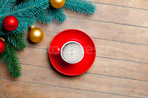 fir tree branches, cup of coffee and colorful baubles on the won Stock photo © Massonforstock