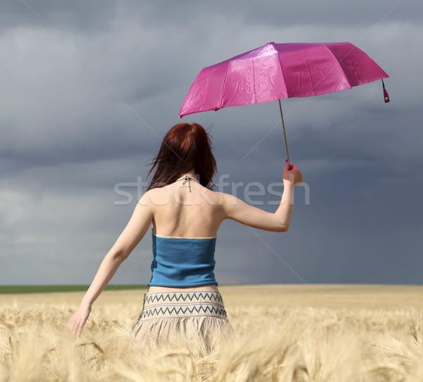 Ragazza campo di grano tempesta giorno ombrello natura Foto d'archivio © Massonforstock