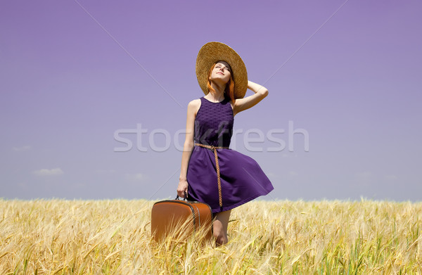 Vörös hajú nő lány bőrönd tavasz búzamező divat Stock fotó © Massonforstock