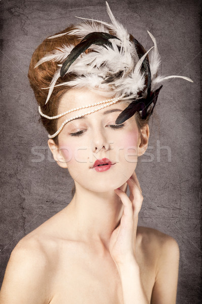 Redhead girl with Rococo hair style at vintage background.  Stock photo © Massonforstock