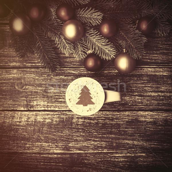 Vrouwelijke beker koffie room kerstboom Stockfoto © Massonforstock