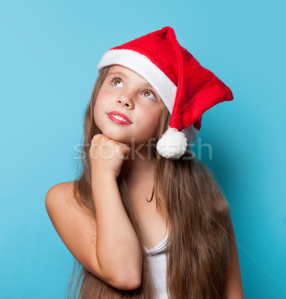 Young smiling girl in Santas hat  Stock photo © Massonforstock