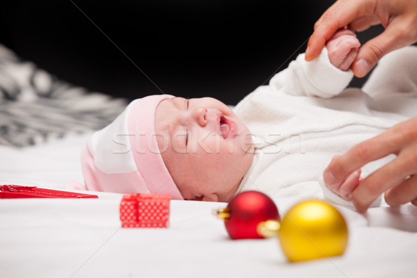 male hands touching cute crying baby near gifts and baubles on t Stock photo © Massonforstock