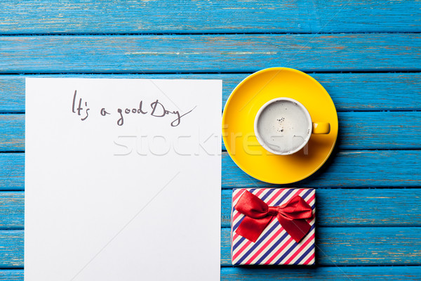 photo of paper It's a good day, cup of coffee and cute gift on t Stock photo © Massonforstock