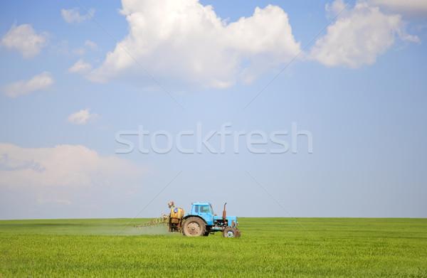 öreg traktor tavasz mező égbolt kő Stock fotó © Massonforstock