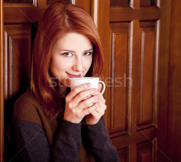 стиль девушки питьевой кофе древесины Сток-фото © Massonforstock