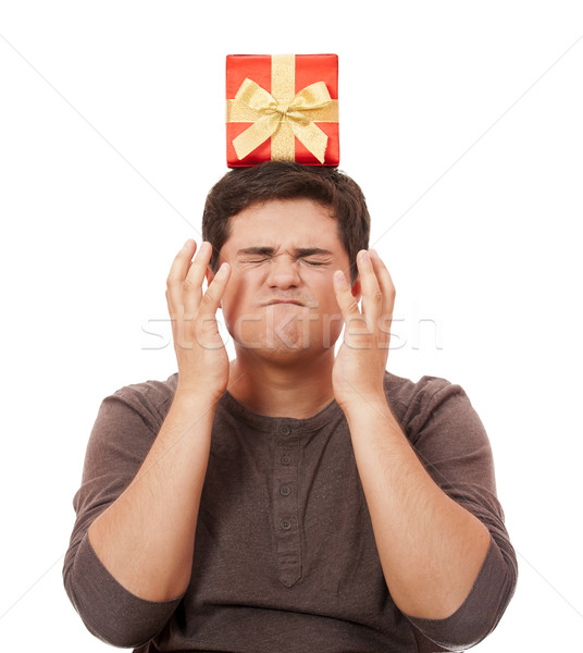 An angry man holding present box on white background. Stock photo © Massonforstock