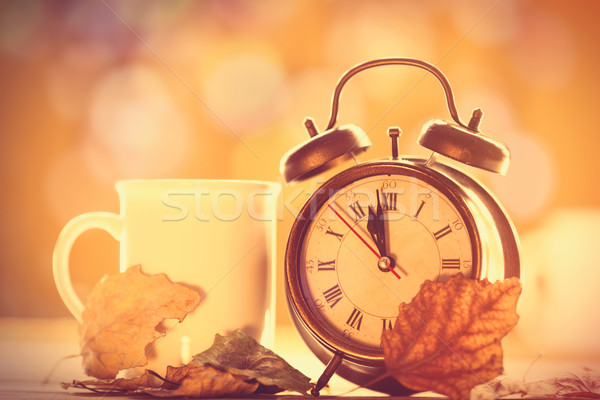 Vintage alalrm clock and cup  Stock photo © Massonforstock