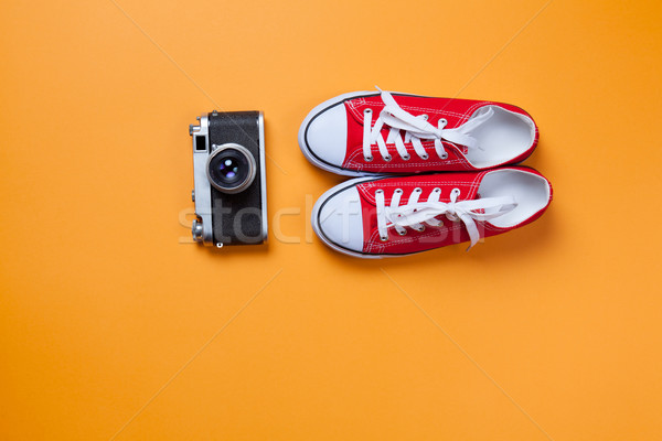 Classic camera and red gumshoes  Stock photo © Massonforstock