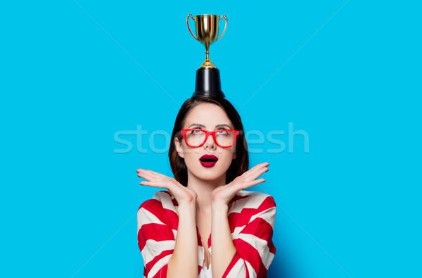 Fiatal meglepődött nő csésze trófea portré Stock fotó © Massonforstock