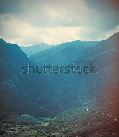 photo of splendid view of huge mountains and small field on the  Stock photo © Massonforstock