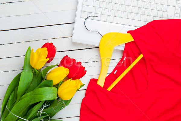 bunch of tulips, jacket on hanger and laptop on the wonderful wh Stock photo © Massonforstock
